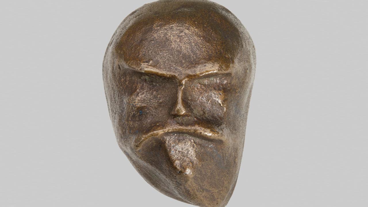 bronzen masker/kopje